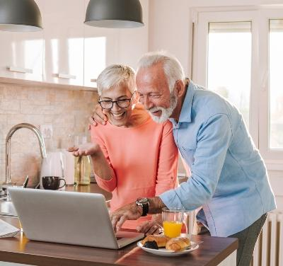 Couple viewing property on laptop